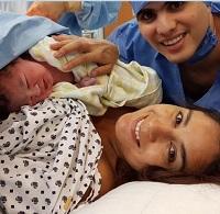 Paola con su bebe